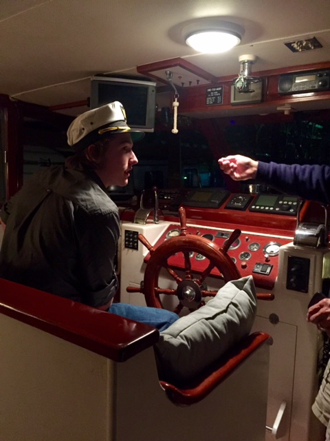 Riley getting some lessons in navigation on board a 54' yacht by a very experience captain.